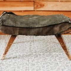 Retro footstool in need of reupholstering
