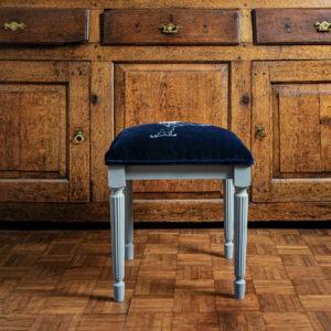 Luxury embroidered dressing table stool in navy velvet